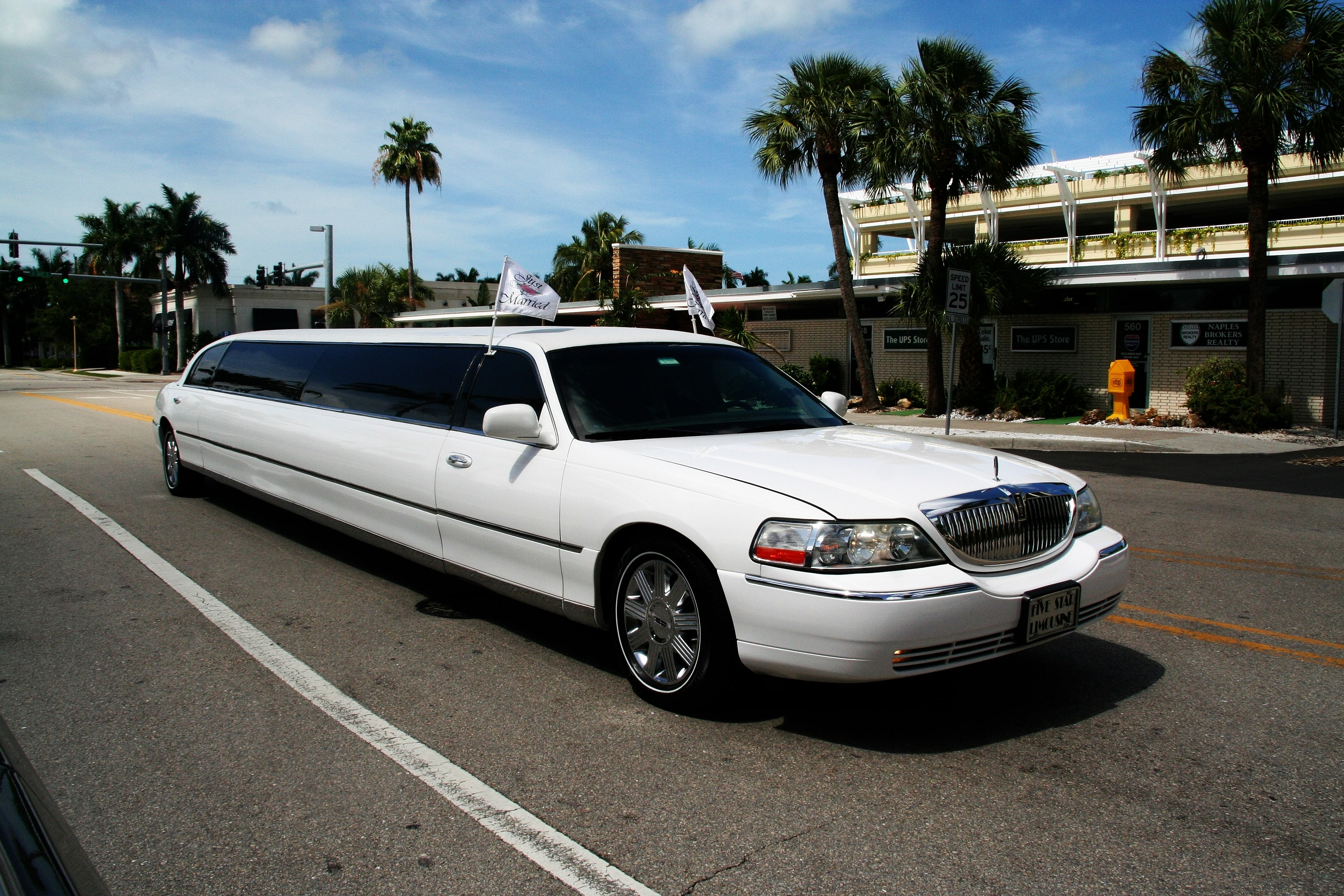 OLDER BUSINESS MAN GETTING OUT OF LIMO HIRE MELBOURNE