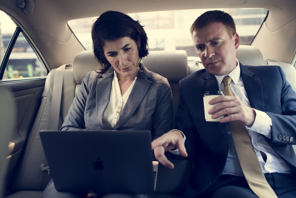 Business men in a limo hire Melbourne